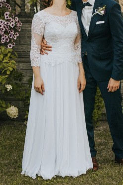 Suknia ślubka o kroju lit. A z koronką