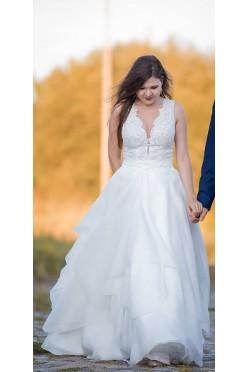Przepiękna suknia z falbanami (body+spódnica)
