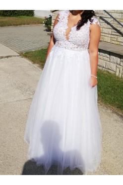Suknia ślubna z koronką na siateczce i tiulowym dołem
