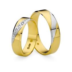 Obrączki z białego i żółtego złota skośne zdobienie cyrkonie