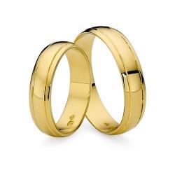 Złote polerowane obrączki ślubne z nacięciami