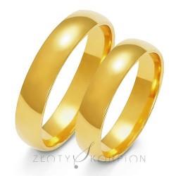 Półokrągłe złote obrączki ślubne soczewka
