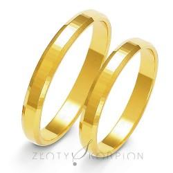 Zdobione płaskie obrączki ślubne