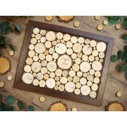 księga gości w ramce z plastrami drewna